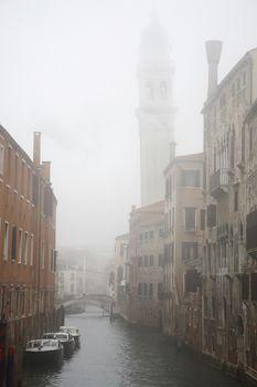Italy Venice canal in fog