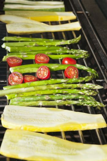Cucumber, tomatoes and asparagus on grill