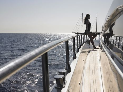 Woman Standing on Deck of Boat