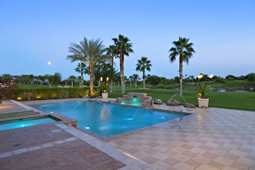 View of swimming pool with lawn in background