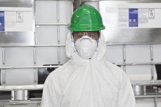 Portrait of male technician in hazmat suit