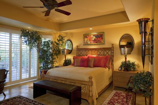 Comfortable bed in luxury manor house