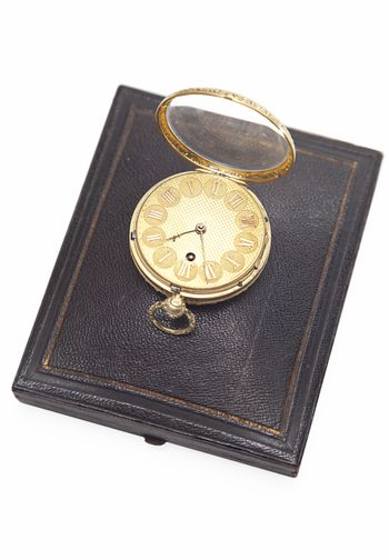 Old-fashioned pocket watch on top of wallet over white background