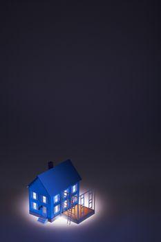 Illuminated model of house