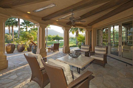 Furniture in patio of luxury villa