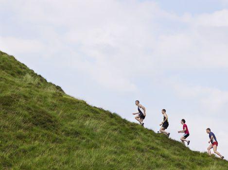 Group running up hillside