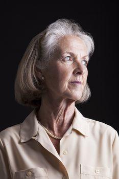 Portrait of thoughtful senior woman