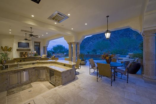 Bar counter with seating furniture in patio of luxury mansion
