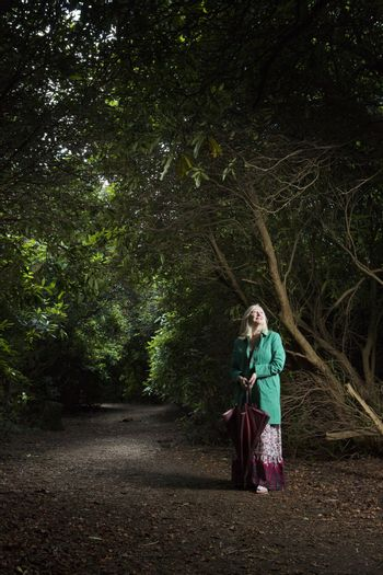 Woman Standing on a Forest Path