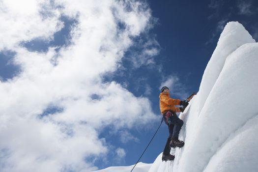 Mountain climber reaching snowy peak