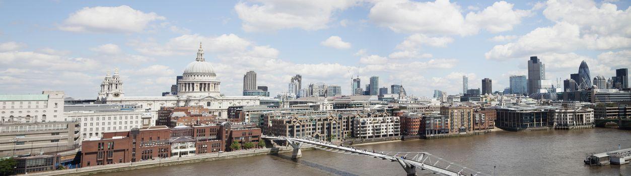 Millennium bridge over River Thames and cityscape, London, England, UK