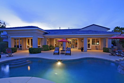 Swimming pool in front of mansion