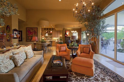 Seating furniture with chandelier in living room of manor house