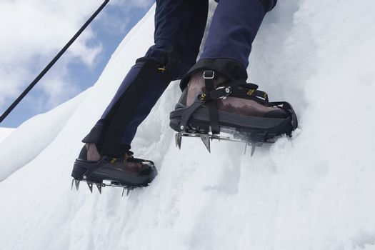 Mountain climber on snowy slope low section