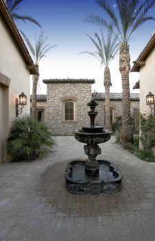 Fountain in luxury villa's courtyard