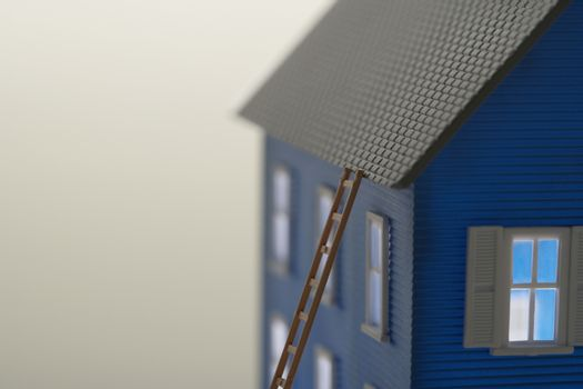 Model of house with ladder close-up