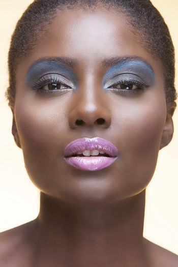 Portrait of young attractive african american woman with full make up on in studio