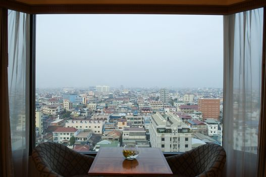 City Seen Through Open Hotel Window