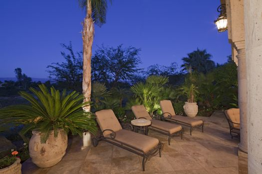 View of chaise lounge in patio of luxury manor house