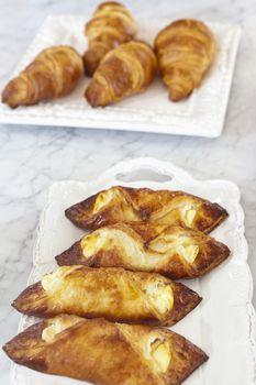 Fresh croissants in serving dish