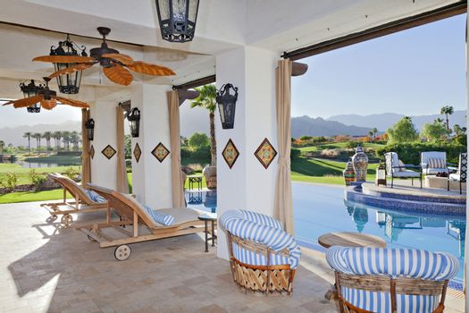 Seating furniture in patio of modern mansion