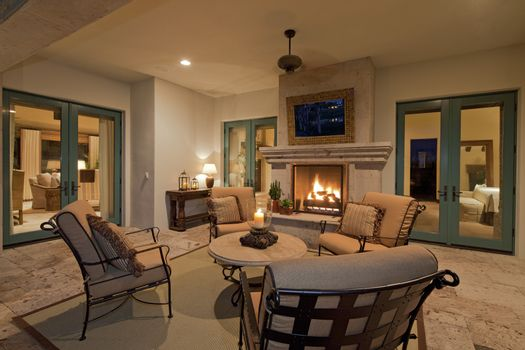 Seating furniture near fireplace in living room of villa