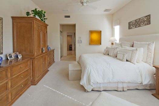 Wooden cabinets and closet in luxury bedroom of villa