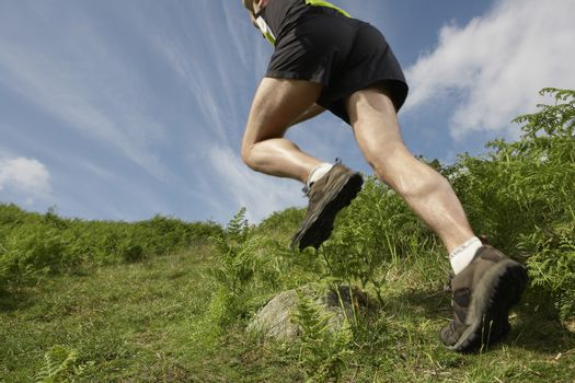 Man hiking in countryside low section