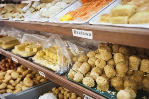 Variety of Indian sweet food displayed at store