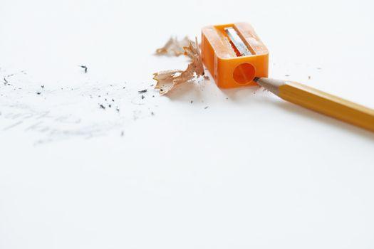 Orange pencil with orange pencil sharpener and shavings