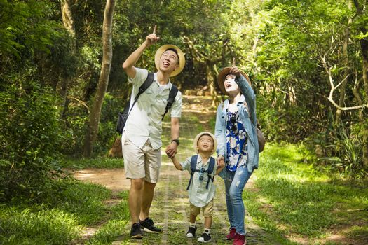 happy family hiking through the forest