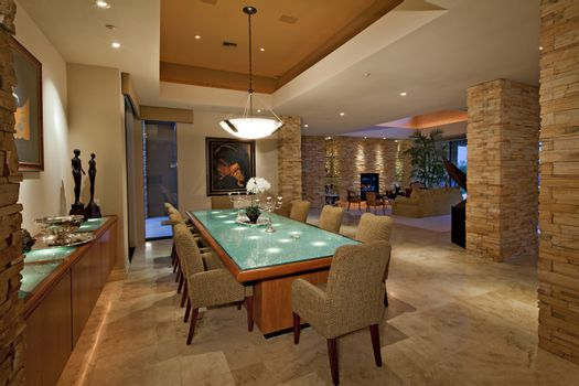 Dining room with chandelier in luxury mansion