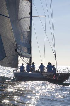 Sailing team on sailboat