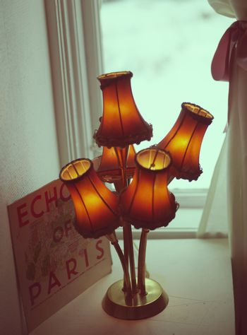 """Old fashioned lamp and """"Echo of Paris' advert"""