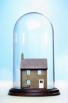 Ceramic house under glass cover