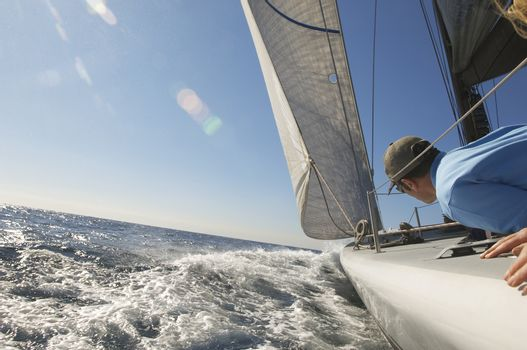 Sailor on yacht in ocean