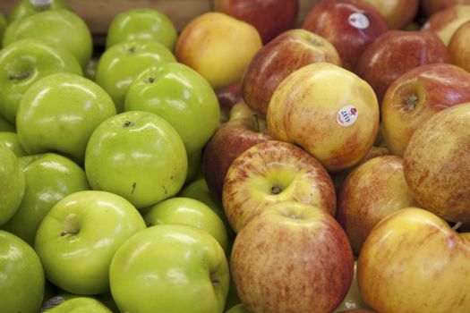 Close-up of apples on display in market