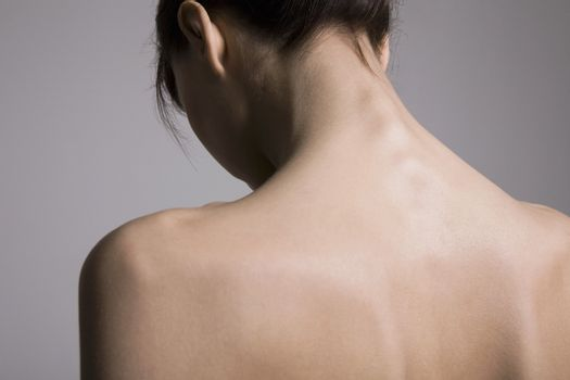 Back view of young woman's back