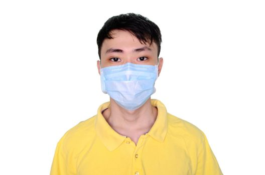 Young asian man in yellow t-shirt wearing medical mask, isolated on white background. Coronavirus or covid-19 protection concept.