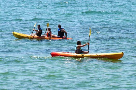 Varna, Bulgaria - July,31,2020: family kayaking on the sea