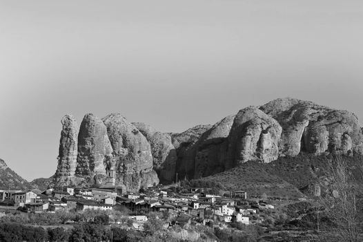 Deserted village in Spain in black and white.  Medieval settlement at the foot of the cliffs in the Spanish Pyrenees.
