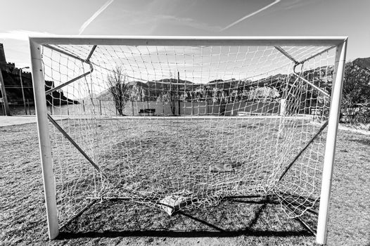 Deserted sports field on the shores of Lake Garda in Italy in black and white.