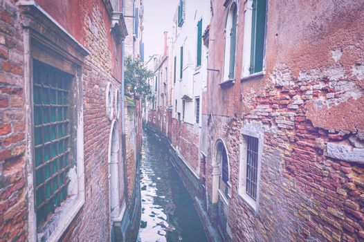 Deserted Venice in faded color effect.  Museum City is situated across a group of islands that are separated by canals and linked by empty bridges.