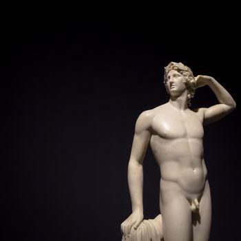 MILAN, ITALY - June 2020:  the ancient sculpture Apollo Crowing Himself - 1782 - Antonio Canova's masterpiece. Intesa Italian Museum.