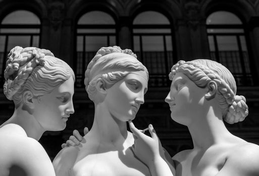 Milan, Italy - June 2020: Bertel Thorvaldsen's statue The Three Graces. Neoclassical sculpture, in marble, of the mythological three charites.