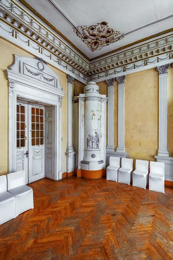 Corner of the room with a stove in the abandoned palace