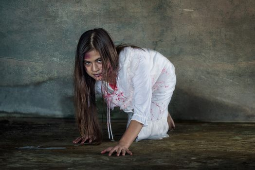 Zombie woman crawling on the floor with bloody