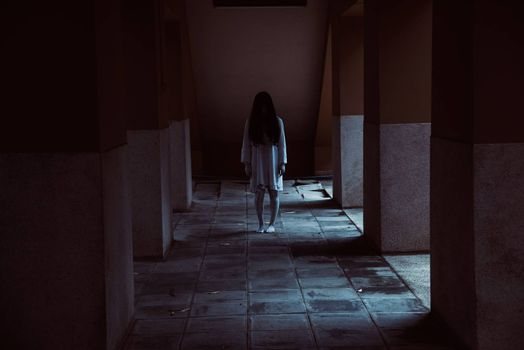 Horror woman ghost creepy standing at the house, halloween day concept