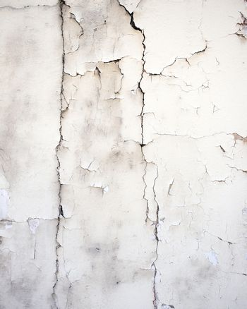 cracked white stucco on old wall