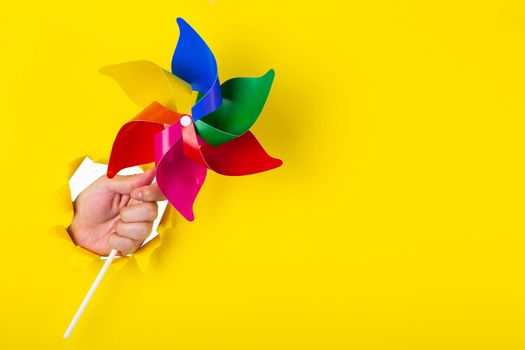 Rainbow fan isolated on yellow background. lgbt symbol colour
